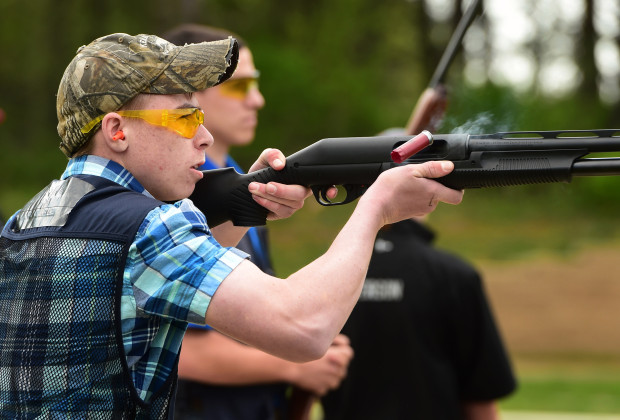 boy shooting, wearing safety glasses