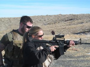 Man and woman doing shooting on the field