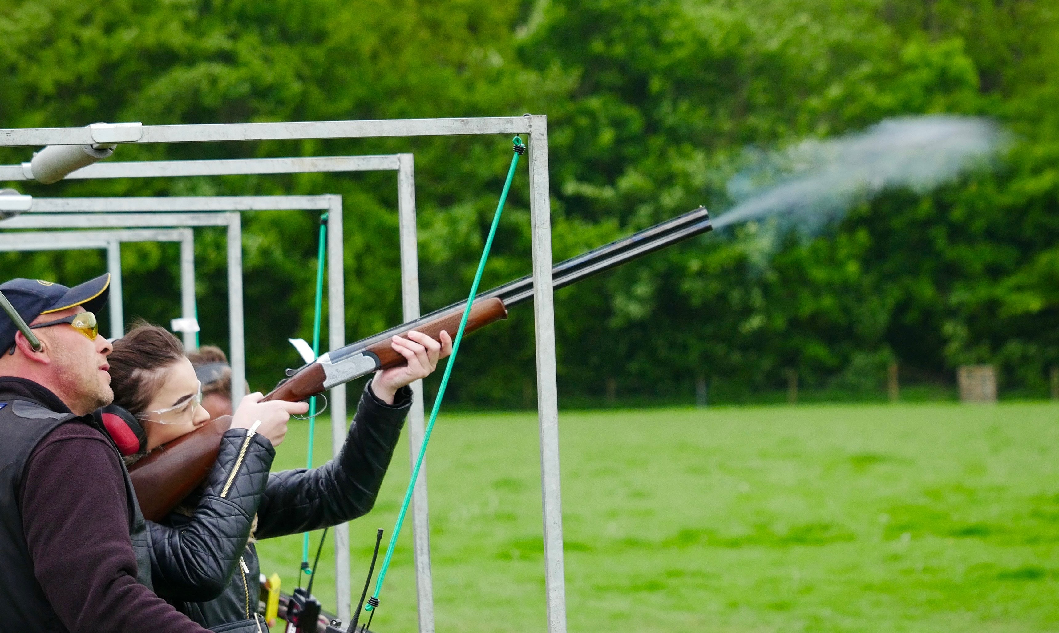 woman shooting clay pigeons
