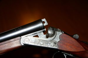 close up of an opened side by side shotguns