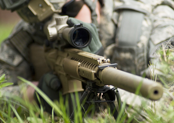 soldier using an optical scope or sight